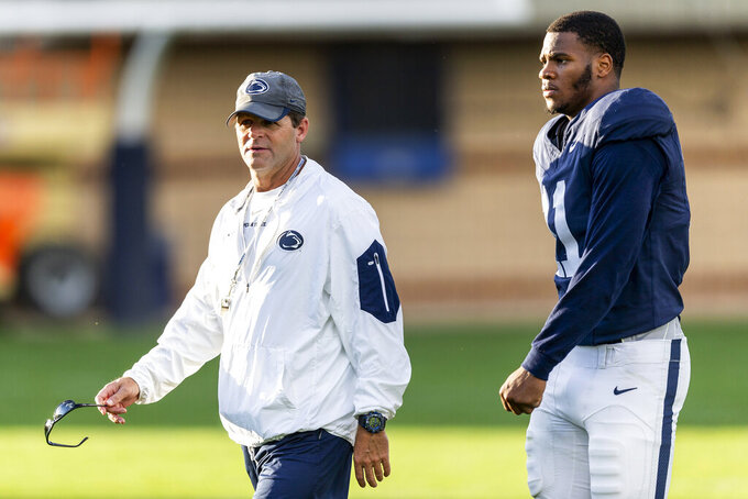 Penn State defensive coordinator Brent Pry talks with linebacker Micah Parsons during the NCAA college football team's practice Wednesday, Aug. 28, 2019, in State College, Pa. (Joe Hermitt/The Patriot-News via AP)