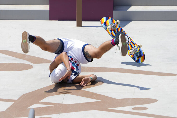 Jagger Eton of the United States falls on his final attempt during the men's street skateboarding finals at the 2020 Summer Olympics, Sunday, July 25, 2021, in Tokyo, Japan. (AP Photo/Jae C. Hong)