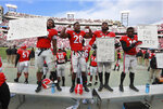 Georgia 0layers, from left, Jonathan Ledbetter, J.R. Reed, D'Andre Walker, and Deandre Baker holds up a sign in the closing minutes of their 45-21 win over Georgia Tech in an NCAA college football game Saturday, Nov. 24, 2018, in Athens, Ga. (Curtis Compton/Atlanta Journal Constitution via AP)