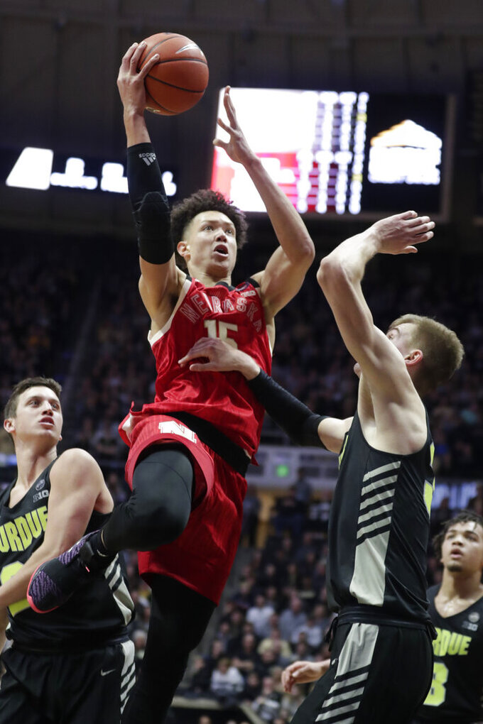 Nebraska forward Isaiah Roby (15) shoots over Purdue center Matt Haarms (32) during the second half of an NCAA college basketball game in West Lafayette, Ind., Saturday, Feb. 9, 2019. (AP Photo/Michael Conroy)