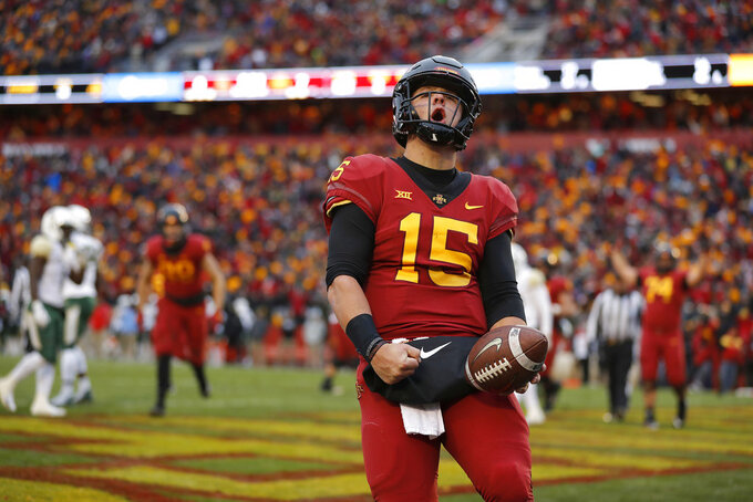 Iowa State quarterback Brock Purdy celebrates his touchdown run during the first half of an NCAA college football game against Baylot, Saturday, Nov. 10, 2018, in Ames. (AP Photo/Matthew Putney)