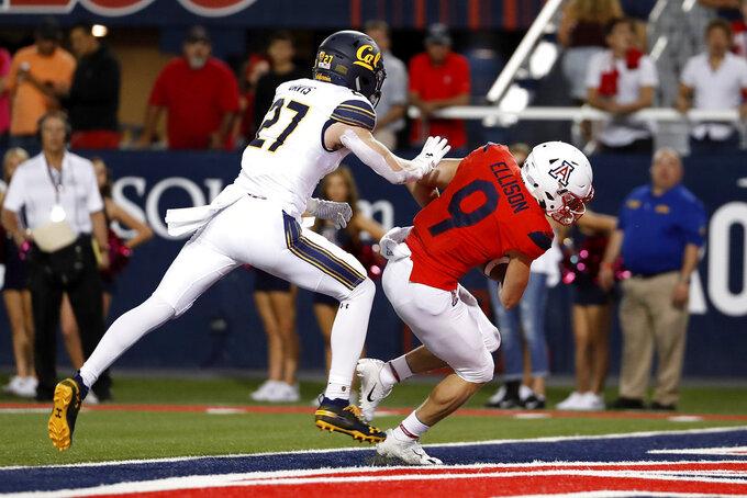Arizona wide receiver Tony Ellison (9) scores a 31-yard touchdown next to California safety Ashtyn Davis (27) during the first half of an NCAA college football game Saturday, Oct. 6, 2018, in Tucson, Ariz. (AP Photo/Chris Coduto)