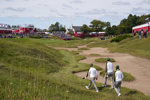 Team Europe's Bernd Wiesberger, Team Europe's Tommy Fleetwood and Team Europe's Viktor Hovland walk up the ninth hole during a practice day at the Ryder Cup at the Whistling Straits Golf Course Wednesday, Sept. 22, 2021, in Sheboygan, Wis. (AP Photo/Jeff Roberson)