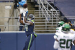 Seattle Seahawks wide receiver DK Metcalf reaches to catch a touchdown pass against the New York Jets during the first half of an NFL football game, Sunday, Dec. 13, 2020, in Seattle. (AP Photo/Lindsey Wasson)