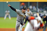 Pittsburgh Pirates starting pitcher Joe Musgrove throws to Houston Astros' Yuli Gurriel, right, during the sixth inning of a baseball game Thursday, June 27, 2019, in Houston. (AP Photo/David J. Phillip)