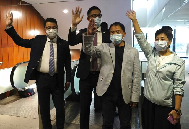 Pro-democracy legislators, from right, Wong Pik Wan, Wu Chi Wai, Lam Cheuk-ting, Yoon Siu Kin wave after handing their letters at Legislative Council in Hong Kong, Thursday day, Nov. 12, 2020. Hong Kong's pro-democracy lawmakers have handed in their resignations following a move by the city's government to disqualify four pro-democracy legislators. (AP Photo/Vincent Yu)