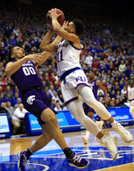Kansas guard Devon Dotson (11) shoots over Kansas State guard Mike McGuirl (00) during the first half of an NCAA college basketball game in Lawrence, Kan., Monday, Feb. 25, 2019. (AP Photo/Orlin Wagner)