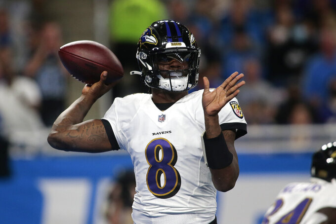 Baltimore Ravens quarterback Lamar Jackson (8) throws against the Detroit Lions in the first half of an NFL football game in Detroit, Sunday, Sept. 26, 2021. (AP Photo/Tony Ding)