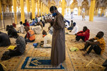 In this photo taken Friday, May 15, 2020, a follower of the Senegalese Mouride brotherhood, an order of Sufi Islam, prays during Muslim Friday prayers at West Africa's largest mosque the Massalikul Jinaan, in Dakar, Senegal. A growing number of mosques are reopening across West Africa even as confirmed coronavirus cases soar, as governments find it increasingly difficult to keep them closed during the holy month of Ramadan. (AP Photo/Sylvain Cherkaoui)