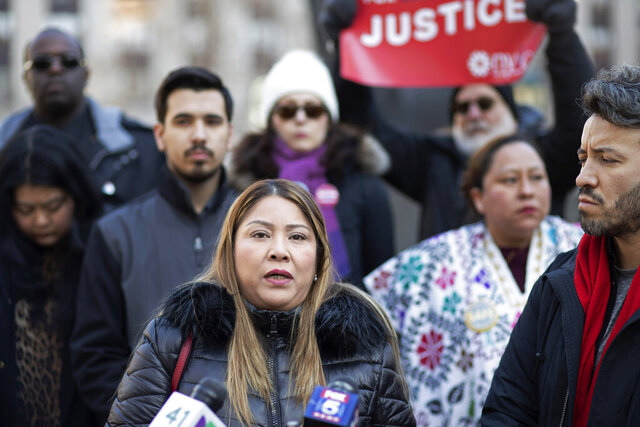 Carmen Cruz, center, speaks at a news conference with several activists to denounce the violence against her son, Erick Díaz Cruz, Friday, Feb. 21, 2020 in New York. The 26-year-old Mexican tourist, who works as an assistant to the mayor of the Mexican city of Martínez de la Torre, was visiting his mother Feb. 6 when he was shot by an Immigration and Customs Enforcement officer during an altercation.