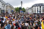 General view of the start of the annual Gay Pride march in Paris, France, Saturday, July 4, 2020. Sign at center reads in French
