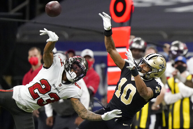 New Orleans Saints wide receiver Tre'Quan Smith (10) cannot catch a pass as he is defended by Tampa Bay Buccaneers cornerback Sean Murphy-Bunting (23) during the second half of an NFL divisional round playoff football game, Sunday, Jan. 17, 2021, in New Orleans. (AP Photo/Brynn Anderson)