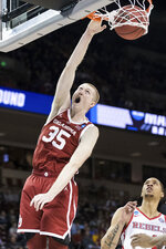 Oklahoma forward Brady Manek (35) dunks the ball as Mississippi forward KJ Buffen, right, looks on during a first round men's college basketball game in the NCAA Tournament Friday, March 22, 2019, in Columbia, S.C. (AP Photo/Sean Rayford)