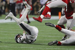 Philadelphia Eagles quarterback Carson Wentz is sacked against the Atlanta Falcons during the fourth quarter of an NFL football game, Sunday, Sept. 15, 2019, in Atlanta. (Curtis Compton/Atlanta Journal-Constitution via AP)