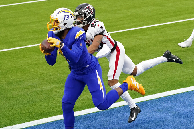 Los Angeles Chargers wide receiver Keenan Allen, left, catches a touchdown pass in front of Atlanta Falcons cornerback A.J. Terrell (24) during the first half of an NFL football game Sunday, Dec. 13, 2020, in Inglewood, Calif. (AP Photo/Ashley Landis)