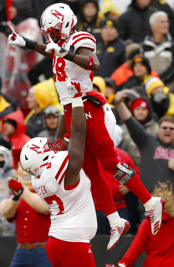 Nebraska running back Maurice Washington celebrates with teammate Jerald Foster, left, after catching a 28-yard touchdown pass during the second half of an NCAA college football game against Iowa, Friday, Nov. 23, 2018, in Iowa City, Iowa. Iowa won 31-28. (AP Photo/Charlie Neibergall)