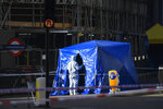Forensic officers attend the scene in central London, Saturday, Nov. 30, 2019, after an attack on London Bridge on Friday. UK counterterrorism police on Saturday searched for clues into how a man imprisoned for terrorism offenses before his release last year managed to stab several people before being tackled by bystanders and shot dead by officers on London Bridge. Two people were killed and three wounded. (AP Photo/Alberto Pezzali)in London, Saturday, Nov. 30, 2019.(AP Photo/Alberto Pezzali)