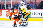 Philadelphia Flyers' Travis Konecny, left, guards Pittsburgh Penguins' Sidney Crosby during the first period of an NHL hockey game, Tuesday, May 4, 2021, in Philadelphia. (AP Photo/Matt Slocum)