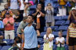 Brandon Nakashima, of the United States, reacts after beating John Isner, of the United States, during the first round of the US Open tennis championships, Monday, Aug. 30, 2021, in New York. (AP Photo/Seth Wenig)
