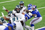 New York Giants running back Wayne Gallman (22) jumps over defenders for a touchdown during the first half of an NFL football game against the Philadelphia Eagles Sunday, Nov. 15, 2020, in East Rutherford, N.J. (AP Photo/Seth Wenig)