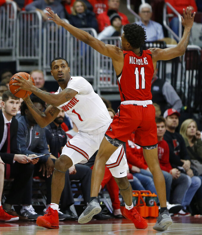Ohio State's Luther Muhammad, left, looks for an open pass as Southeast Missouri State's DQ Nicholas defends during the first half of an NCAA college basketball game, Tuesday, Dec. 17, 2019, in Columbus, Ohio. (AP Photo/Jay LaPrete)