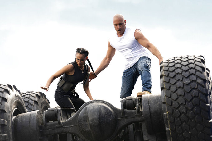 """This image released by Universal Pictures shows Nathalie Emmanuel, left, and Vin Diesel in a scene from """"F9."""" (Giles Keyte/Universal Pictures via AP)"""