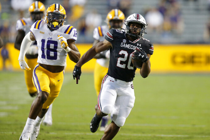 South Carolina running back Kevin Harris (20) runs the ball for a touchdown against LSU during first half of an NCAA college football game in Baton Rouge, La. Saturday, Oct. 24, 2020. (AP Photo/Brett Duke)
