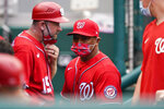 Washington Nationals manager Dave Martinez, center, walks in the dugout during the sixth inning of the second baseball game of the team's doubleheader against the Atlanta Braves at Nationals Park, Wednesday, April 7, 2021, in Washington. The Braves won 2-0. (AP Photo/Alex Brandon)