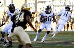 Pittsburgh's Qadree Ollison (30) looks for running room during the second half of the NCAA college football game against Wake Forest Saturday, Nov. 17, 2018, in Winston-Salem, N.C. (AP Photo/Woody Marshall)