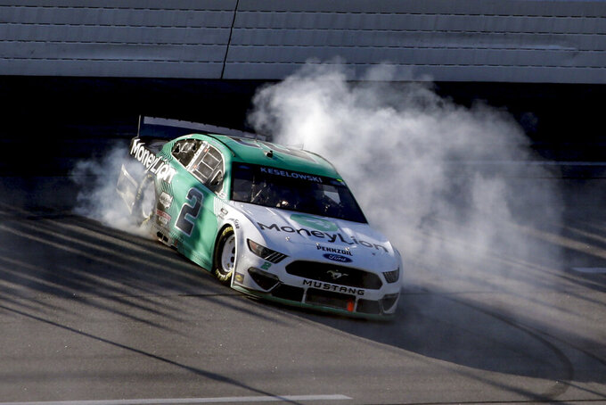 Brad Keselowski (2) celebrates with a burnout after winning the Geico 500 NASCAR Sprint Cup auto race at Talladega Superspeedway, Sunday, April 25, 2021, in Talladega, Ala. (AP Photo/Butch Dill)