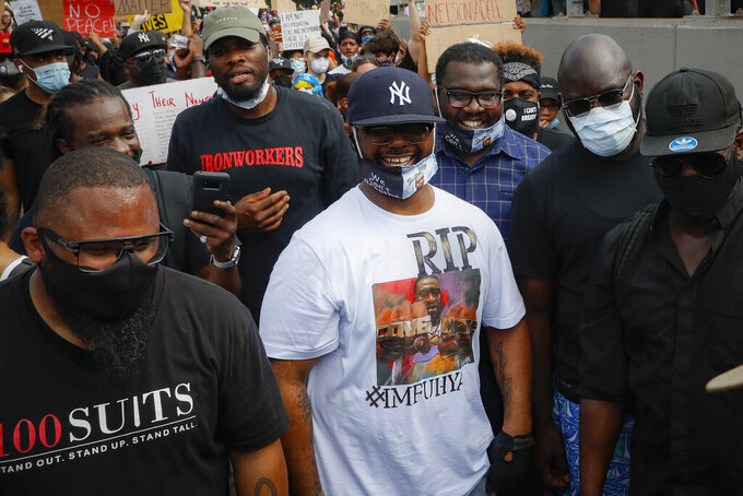 Terrence Floyd, center, brother of the deceased George Floyd, marches onto the Brooklyn Bridge after a rally at Cadman Plaza Park, Thursday, June 4, 2020, in the Brooklyn borough of New York. Protests continued following the death of George Floyd, who died after being restrained by Minneapolis police officers on May 25. (AP Photo/John Minchillo)