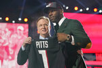Florida tight end Kyle Pitts, right, holds a jersey with NFL Commissioner Roger Goodell after he was chosen by the Atlanta Falcons with the fourth pick in the NFL football draft, Thursday, April 29, 2021, in Cleveland. (AP Photo/Tony Dejak)