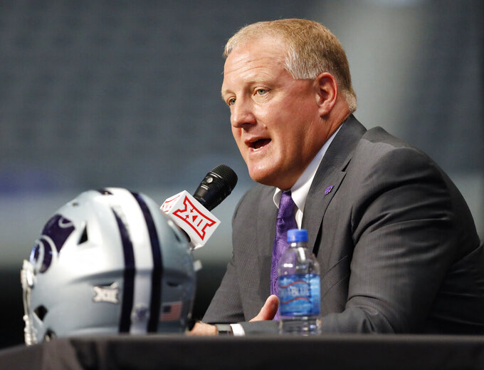 FILE - In this July 16, 2019, file photo, Kansas State head coach Chris Klieman speaks during Big 12 Conference NCAA college football media day, at AT&T Stadium in Arlington, Texas. New Kansas State coach Chris Klieman has seven championship rings, all at the FCS level. Texas Tech's Matt Wells is coming off a successful stretch at his alma mater in the Mountain West Conference. Their Big 12 debuts will be their first games as head coach of a Power Five team. (AP Photo/David Kent, File)
