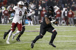 Cincinnati running back Michael Warren II (3) runs in for a touchdown during the second half of an NCAA college football game against Temple, Saturday, Nov. 23, 2019, in Cincinnati. (AP Photo/John Minchillo)