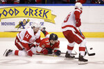 Florida Panthers' Frank Vatrano (77) looks for the puck as Detroit Red Wings' Filip Zadina (11) and Christoffer Ehn (70) defend during the second period of an NHL hockey game, Saturday, Dec. 28, 2019, in Sunrise, Fla. (AP Photo/Luis M. Alvarez)