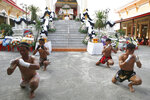In this Thursday, Nov. 15, 2018, photo, Thai boxers perform their traditional dance showing respect at the coffin of 13-year-old Thai kickboxer Anucha Tasako during his funeral services in Samut Prakan province, Thailand. Anucha died of a brain hemorrhage two days after he was knocked out in a bout on Nov. 10 that was his 174th match in the career he started at age 8. Thai lawmakers recently suggested barring children younger than 12 from competitive boxing, but boxing enthusiasts strongly oppose the change. (AP Photo/Sakchai Lalit)