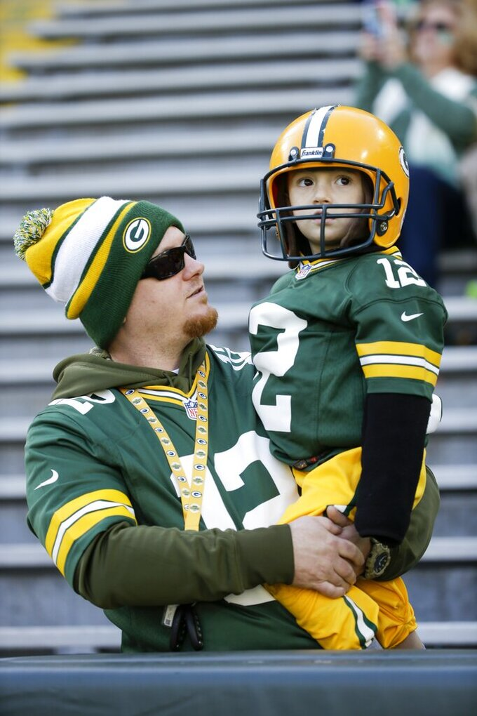 Green Bay Packers fans watch warm ups before an NFL football game against the Oakland Raiders Sunday, Oct. 20, 2019, in Green Bay, Wis. (AP Photo/Mike Roemer)