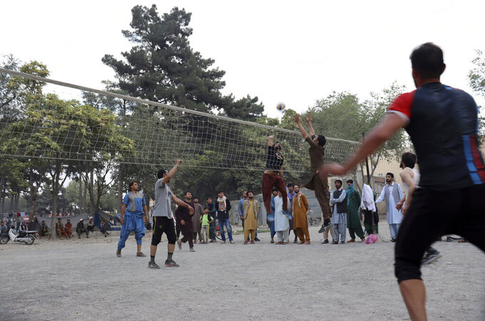 Afghans play volleyball at Shahr-e-Now Park, in Kabul, Afghanistan, Monday, Aug. 30, 2021. Many Afghans are anxious about the Taliban rule and are figuring out ways to get out of Afghanistan. But it's the financial desperation that seems to hang heavy over the city. (AP Photo/Khwaja Tawfiq Sediqi)