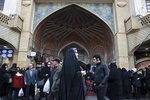 In this Thursday, Feb. 7, 2019, photo, people walk around the Grand Bazaar in Tehran, Iran. Lashed by criticism over his collapsing nuclear deal, Iran's President Hassan Rouhani faces an uncertain future amid a renewed hard-line effort to drive him from office years before his elected term ends. Iranian presidents typically see their popularity erode during their second four-year terms. But analysts say Rouhani is particularly vulnerable because of the economic crisis assailing the country's rial currency, which has hurt ordinary Iranians and emboldened critics to call for his ouster. (AP Photo/Vahid Salemi)