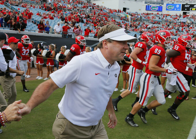 Georgia coach Kirby Smart takes the field with his team for pregame warm ups prior to an NCAA college football game against Florida, Saturday, Oct. 27, 2018 in Jacksonville, Fla. (Bob Andres/Atlanta Journal-Constitution via AP)