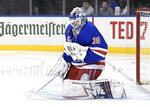 New York Rangers goaltender Henrik Lundqvist stops the puck during the first period of the team's NHL hockey game against the New Jersey Devils on Saturday, March 9, 2019, at Madison Square Garden in New York. (AP Photo/ Bill Kostroun)