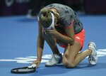 Belgium's Elise Mertens reacts after defeating Romania's Simona Halep in a final match of the the Qatar Open tennis tournament in Doha, Qatar, Saturday, Feb. 16, 2019. (AP Photo/Kamran Jebreili)