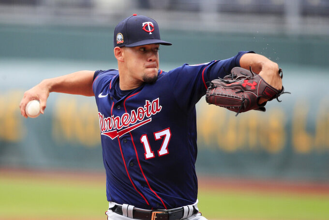 Minnesota Twins starting pitcher Jose Berrios delivers to a Kansas City Royals batter during the first inning of a baseball game at Kauffman Stadium in Kansas City, Mo., Sunday, Aug. 9, 2020. (AP Photo/Orlin Wagner)