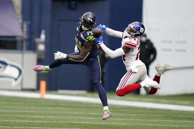 New York Giants cornerback James Bradberry, right, breaks up a pass intended for Seattle Seahawks wide receiver DK Metcalf, left, during the first half of an NFL football game, Sunday, Dec. 6, 2020, in Seattle. (AP Photo/Elaine Thompson)
