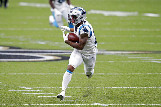 Carolina Panthers wide receiver D.J. Moore (12) pulls in a touchdown reception in the first half of an NFL football game against the New Orleans Saints in New Orleans, Sunday, Oct. 25, 2020. (AP Photo/Butch Dill)