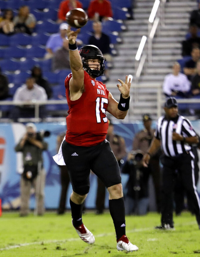 Northern Illinois quarterback Marcus Childers (15) passes during the first half of the Boca Raton Bowl NCAA college football game against UAB, Tuesday, Dec. 18, 2018, in Boca Raton, Fla. (AP Photo/Lynne Sladky)