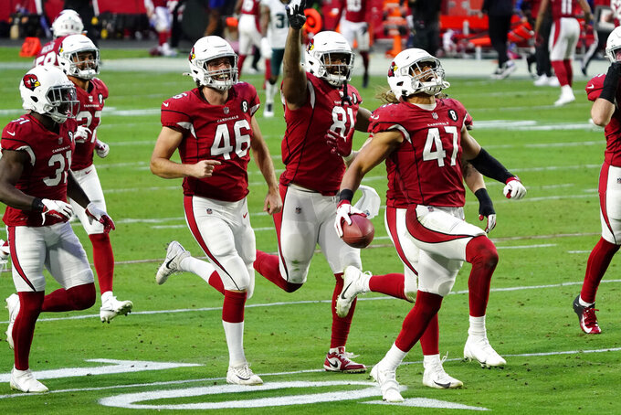 Arizona Cardinals linebacker Zeke Turner (47) celebrates his interception against the Philadelphia Eagles during the second half of an NFL football game, Sunday, Dec. 20, 2020, in Glendale, Ariz. (AP Photo/Rick Scuteri)