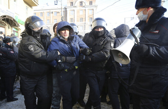 Police detain a man during a protest against the jailing of opposition leader Alexei Navalny in Siberian city of Omsk, Russia, Saturday, Jan. 23, 2021. Russian police on Saturday arrested hundreds of protesters who took to the streets in temperatures as low as minus-50 C (minus-58 F) to demand the release of Alexei Navalny, the country's top opposition figure.  Navalny, President Vladimir Putin's most prominent foe, was arrested on Jan. 17 when he returned to Moscow from Germany, where he had spent five months recovering from a severe nerve-agent poisoning that he blames on the Kremlin. (AP Photo)