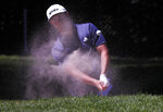 Jon Rahm hits from a sand trap on the first day of competition of the WGC-Mexico Championship at the Chapultepec Golf Club in Mexico City, Thursday, Feb. 21, 2019. (AP Photo/Marco Ugarte)