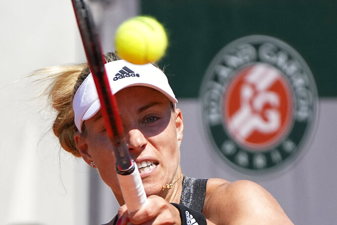Germany's Angelique Kerber returns the ball to Ukraine's Anhelina Kalinina during their first round match of the French Open tennis tournament at the Roland Garros stadium Sunday, May 30, 2021 in Paris. (AP Photo/Michel Euler)